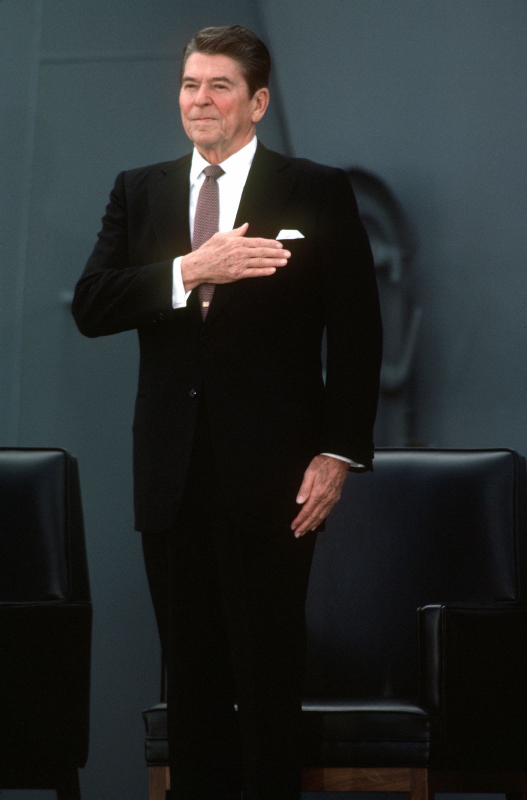 president ronald reagan stands as the national anthem is played during the f9673c 1600